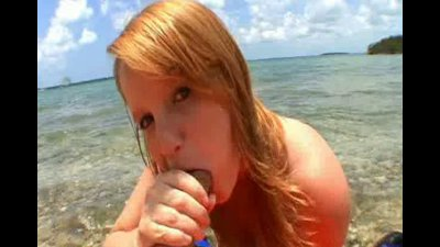 short haired blonde sucking cock at the beach