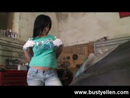 Busty Ellen stripping to the nude in a dirty garage