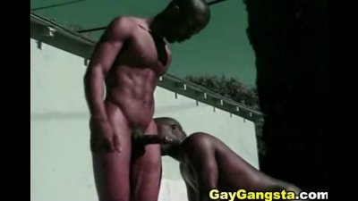 Black dude fucks black booty under the hot sun