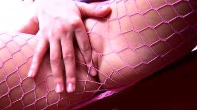 Pigtailed brunette fishnet pantyhose masturbation