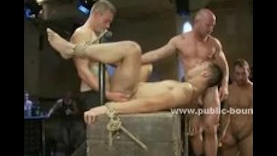 Ropes fix hands of gay slut in public club orgy video with experi