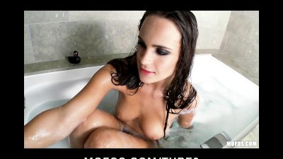 Brunette babe Teal Conrad fucks herself with a dildo in the bath