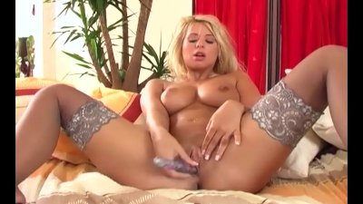 Babe with big tits in stockings fingers her pussy