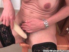 Granny in black stockings masturbates her hairy pussy with dildo
