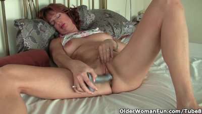 Mature redheaded mom masturbates with sex toys