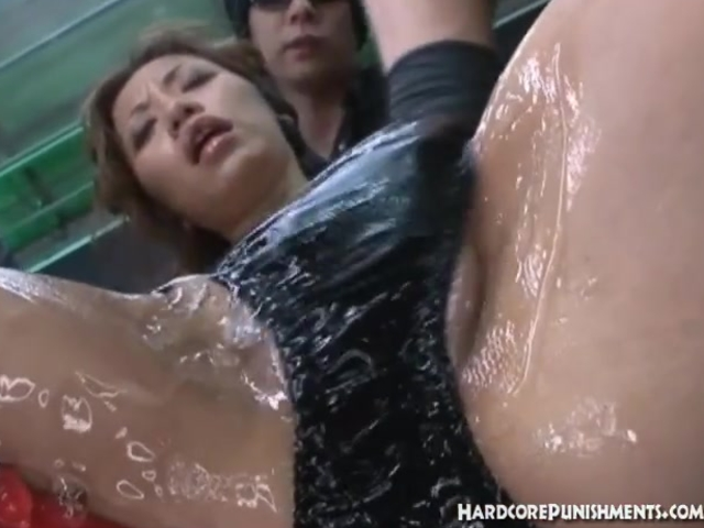 Oriental women is laid down and greased up for sex tools