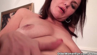 Sexy milf with big tits works her hairy pussy