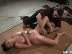Her nipples are given electric shocks as she plays with wand on her pussy