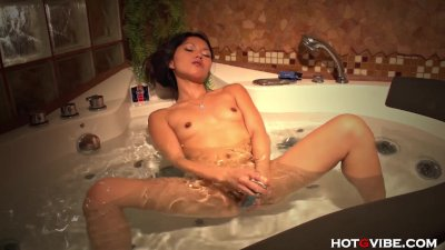 Asian Teen Fucks Herself in Clear Bathtub