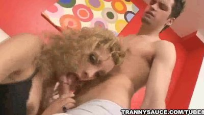 Yummy blonde tranny babe sucking on a hard cock
