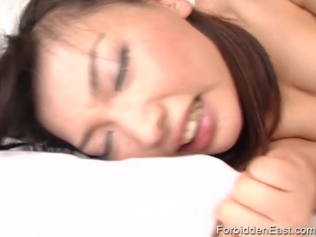Sexy Asian babe is bent over for a good hard fucking