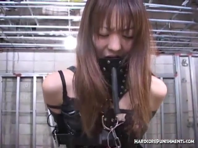 Oriental women has her pussy lips pegged in BDSM