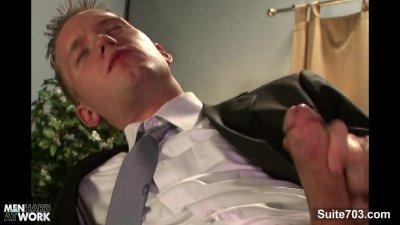 Elegant Sean Preston wanking his large cock at work