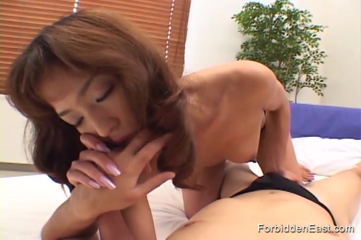 Sexy Asian woman eagerly sucks and jerks a hard cock