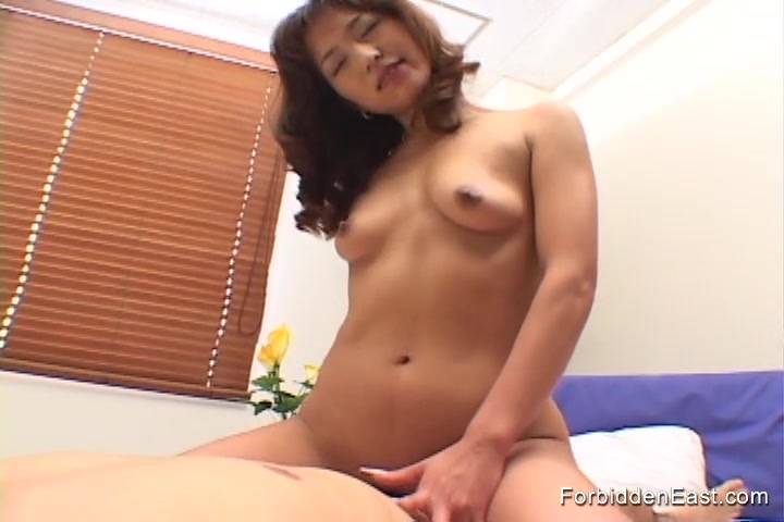 Beautiful Asian with pert tits rides hard cock to orgasm