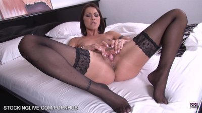 Cindy Hope is enjoying the stockings on her feet while masturbating