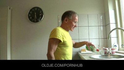 Daring young brunette fucks hard grandpa in the kitchen