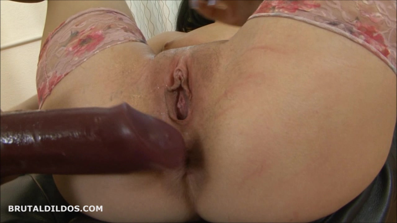 Brunette babe masturbating with two big brutal dildos in HD