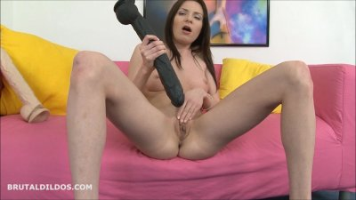 Brunette masturbating with a long black brutal dildo in HD