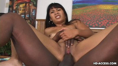 Brunette Asian tramp has a black cock up in her