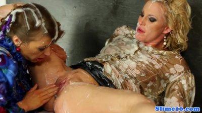 Gloryhole lesbians cum covered with bukkake