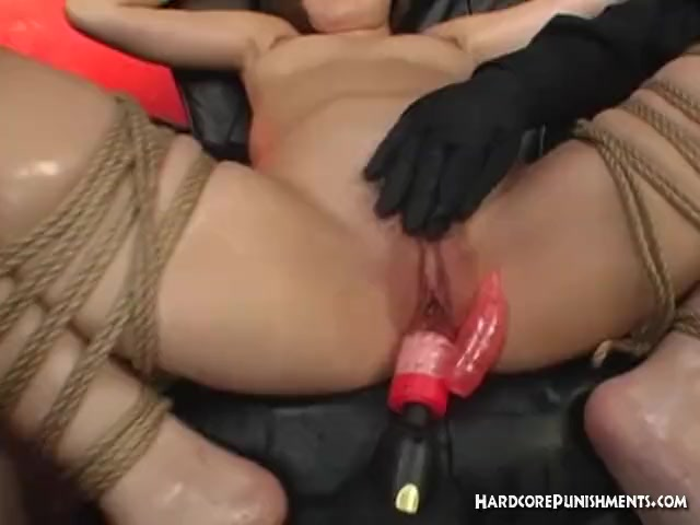 Sexy Oriental woman brought to orgasm with hitachi magic wands