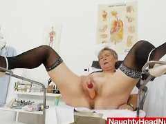 Mama masturbation with a pussy expander in uniforms