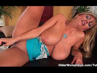 Gorgeous milf with big tits fucks herself with a dildo