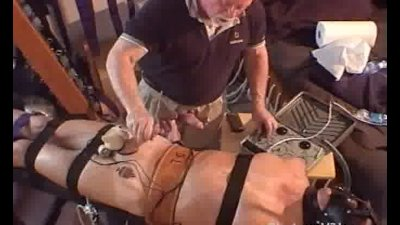 Bound muscle hunk gets elecro stim testicle punishment.