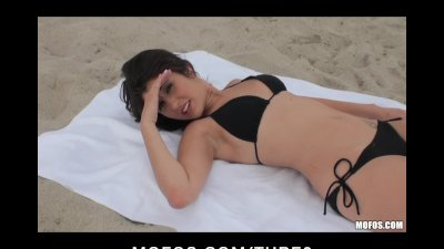 Hot Brunette Teen tanning on the beach fucks a stranger's bigdick