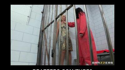 Busty lesbian prisoner makes a