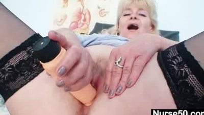 Aged blond lady shows off natural tits and dildo skills