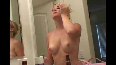 Topless applying makeup