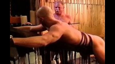 Caning my hot buddy's muscle butt.