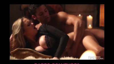 Bigboobed blond is laid down for passionate sex by the fireplace