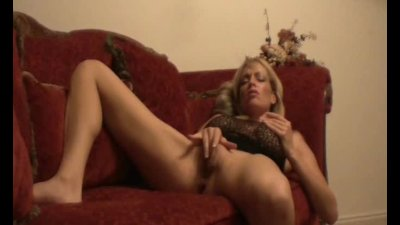 MILF Fucks Self On Couch