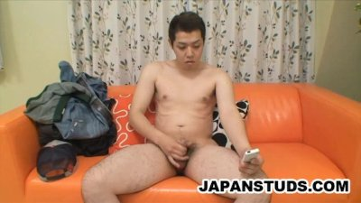 Japanese dude stroking his cock on camera