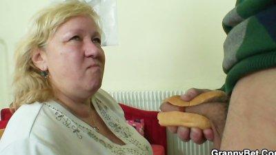 Huge granny tastes his cock th