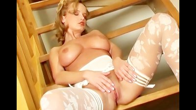 Busty babe in lingerie and panties rubs her pussy