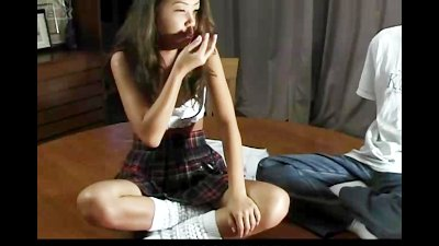 Sexy japanese babe in uniform with mini skirt stripping off