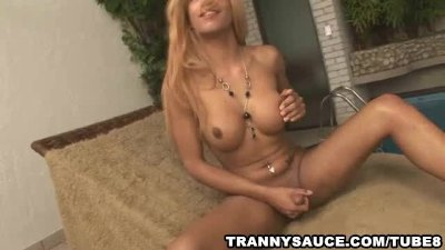 Blonde tranny tugging on her stiff dick