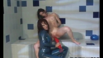 Latex lezdom games in a shower