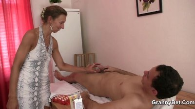 Granny masseuse sucks and rides his dick