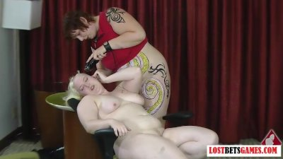 Two bigger girls play strip games.