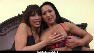 Alluring Asian gals enjoy a smutty threesome