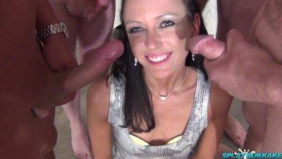 Sexy Brunette Roxy sucks dicks in a bukkake