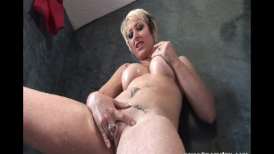 Sexy blonde MILF Tracy Venus fingers her pussy in the shower