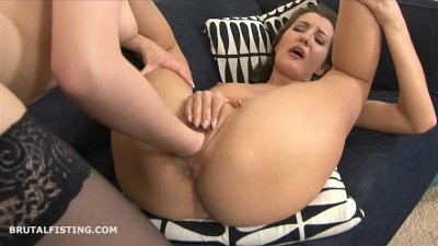 Brunette lesbian fisting her friends tight pussy