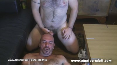 Two Hairy Beefy Guys Give Each Other Blowjobs