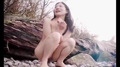 Asian slut is on the beach nak
